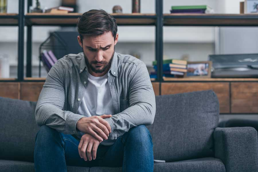 man sitting and grieving counselling help