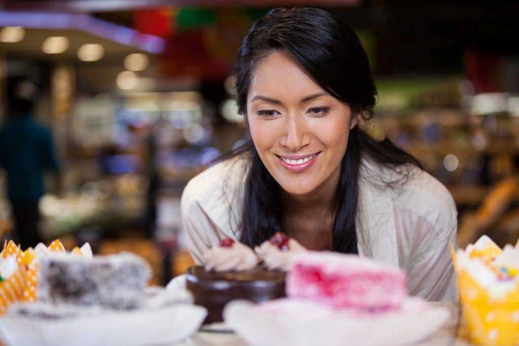 woman looking at different food choices
